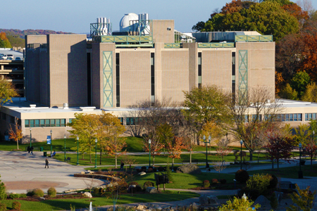 front view of outside hall with trees and students